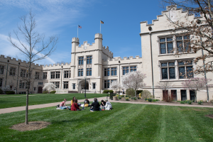 Kauke Hall with small class in a circle in foreground