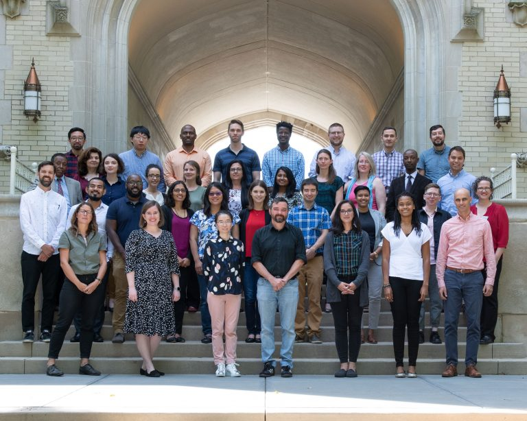 40 new College of Wooster professors in front of Kauke Arch