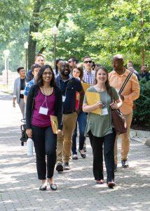 New faculty walking on path in Oak Grove